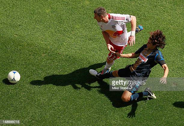 Kenny Cooper of the New York Red Bullsbattles for control of the ball against Gabriel Farfan of the Philadelphia Union at Red Bull Arena on July 21...