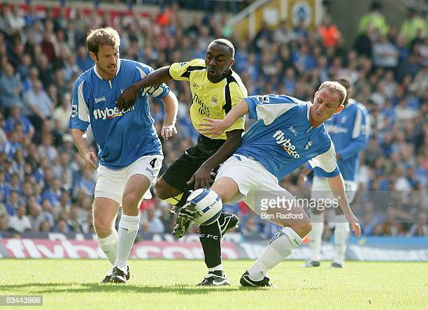 Kenny Cunningham and Nicky Butt of Birmingham attempt to rob Darius Vassell of Man City during the Barclays Premiership match between Birmingham City...