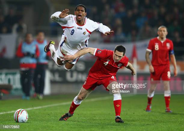 Kenny Cunningham of Costa Rica is challenged by Andrew Crofts of Wales during the Gary Speed Memorial International Match between Wales and Costa...
