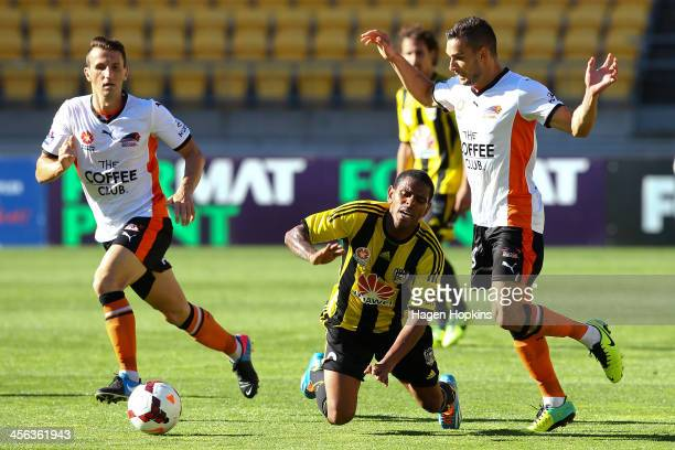 Kenny Cunningham of the Phoenix is brought down in the challenge of Jack Hingert of the Roar during the round 10 ALeague match between the Wellington...
