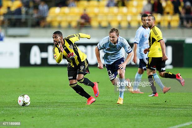 Kenny Cunningham of the Phoenix makes a break from Rhyan Grant of Sydney FC during the round 26 ALeague match between the Wellington Phoenix and...