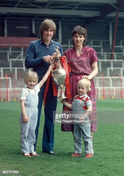 Kenny Dalglish and his wife Marina with their children Kelly and Paul posing with the Football League Championship trophy at Anfield in Liverpool...