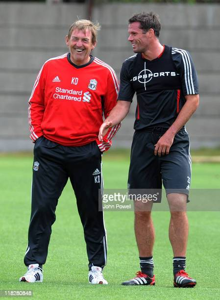 Kenny Dalglish and Jamie Carragher of Liverpool attend a Liverpool training session at Melwood Training Ground on July 6 2011 in Liverpool England