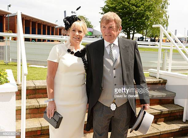 Kenny Dalglish and Marina Dalglish attend Derby Day at the Investec Derby Festival at Epsom Downs Racecourse on June 6 2014 in Epsom England