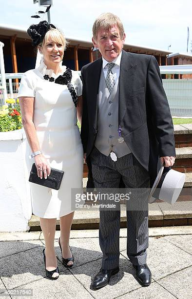 Kenny Dalglish and Marina Dalglish attends Derby day at the Investec Derby Festival at Epsom Racecourse on June 7 2014 in Epsom England