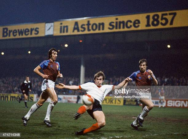Kenny Dalglish evades West Ham defenders Billy Bonds and Geoff Pike to score the first goal for Liverpool during the League Cup Final Replay between...