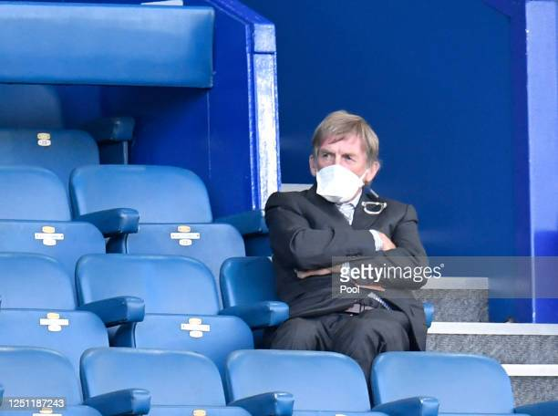 Kenny Dalglish is seen in the stands while wearing a face mask during the Premier League match between Everton FC and Liverpool FC at Goodison Park...