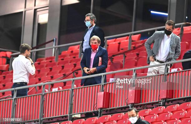 Kenny Dalglish is seen in the stands while wearing a face mask during the Premier League match between Liverpool FC and Crystal Palace at Anfield on...