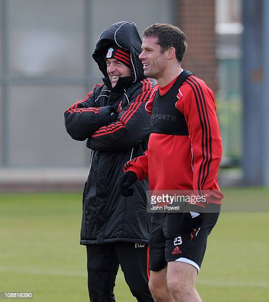 Kenny Dalglish manager of Liverpool and Jamie Carragher during a training session at Melwood Training Ground on February 4 2011 in Liverpool England