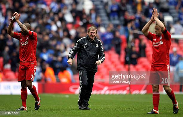 Kenny Dalglish manager of Liverpool celebrates victory with Glen Johnson and Jay Spearing after the FA Cup with Budweiser Semi Final match between...