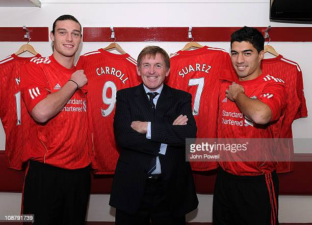 Kenny Dalglish manager of Liverpool poses with new signings Andy Carroll and Luis Suarez at Anfield on February 3 2011 in Liverpool England
