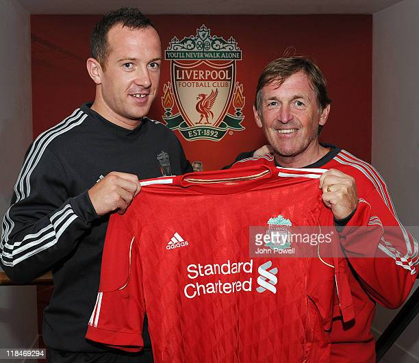 Kenny Dalglish Manager of Liverpool with his new signing Charlie Adam at Melwood Training Ground on July 6 2011 in Liverpool England