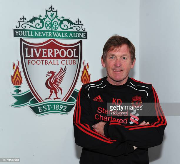 Kenny Dalglish newly appointed manager of Liverpool poses for a portrait during a Liverpool training session at Melwood Training Ground on January 10...
