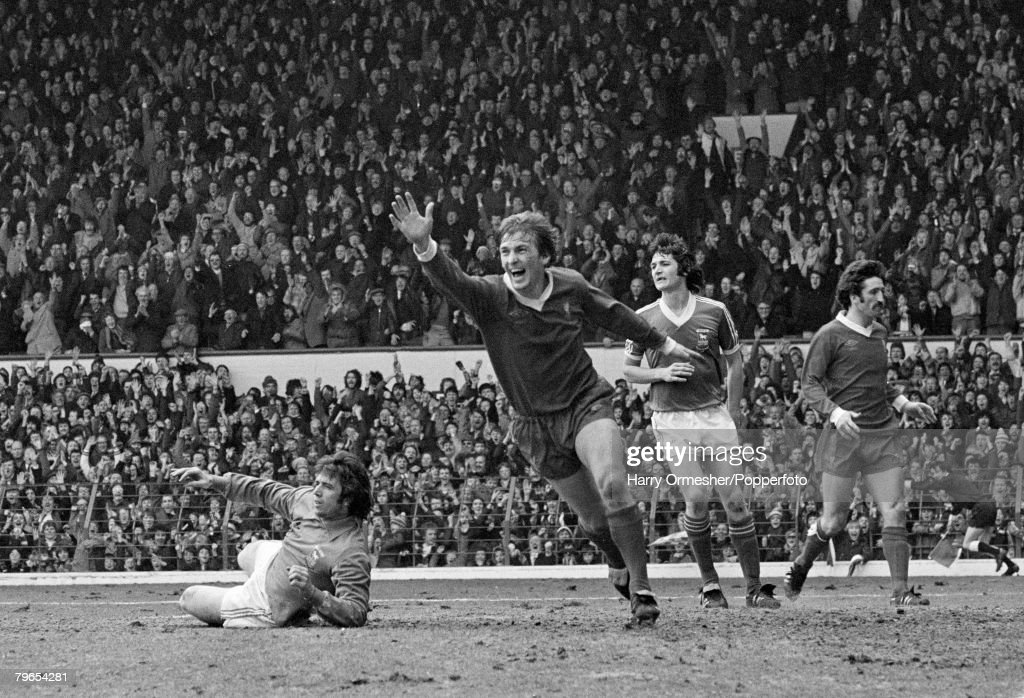Football, 24th March, 1979, Liverpool v Ipswich Town, Kenny Dalglish of Liverpool, celebrates his goal, while Ipswich goal-keeper, Paul Cooper lies dejectedly on the floor : News Photo