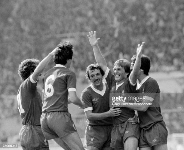 Kenny Dalglish of Liverpool celebrates with teammates after scoring during the FA Charity Shield between Arsenal and Liverpool at Wembley Stadium on...