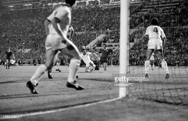 Kenny Dalglish of Liverpool is challenged by the AS Roma defence as he looks to score a goal during the UEFA European Cup Final between AS Roma and...