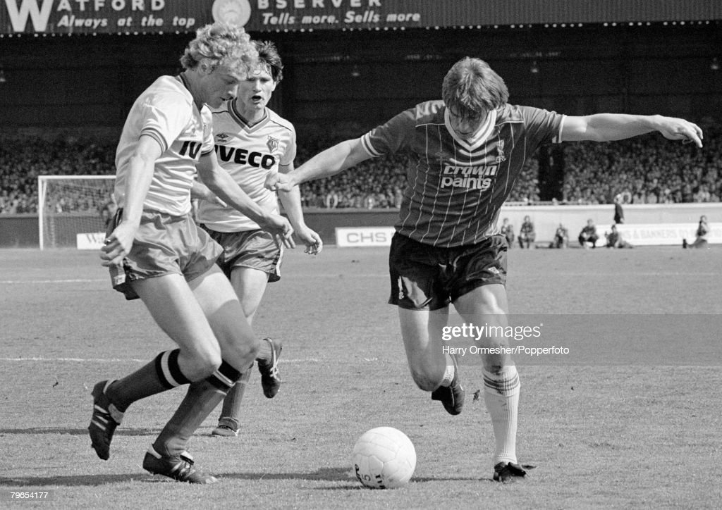 14th May 1983, Vicarage Road, Watford, Watford 2 v Liverpool 1, Liverpool's Kenny Dalglish moves forward watched by Watford's Pat Rice and Les Taylor : News Photo