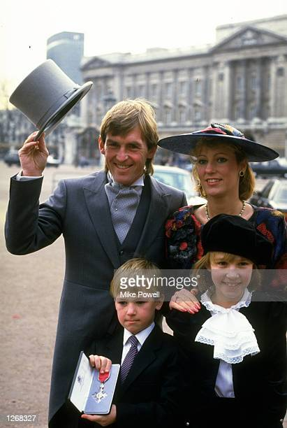 Kenny Dalglish poses for photographers with his wife Marina and children Paul and Kelly after being presented with an MBE at Buckingham Palace in...