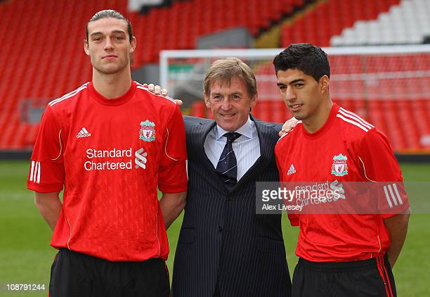 Kenny Dalglish the manager of Liverpool stands between his new signings Andy Carroll and Luis Suarez during a photocall at Anfield on February 3 2011...