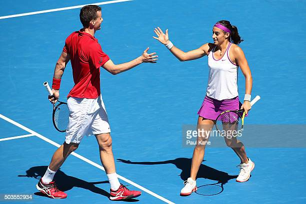Kenny De Schepper and Caroline Garcia of France celebrate a point in the mixed doubles match against Sabine Lisicki and Alexander Zverev of Germany...