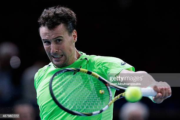 Kenny De Schepper of France in action against Jeremy Chardy of France during day 2 of the BNP Paribas Masters held at the at Palais Omnisports de...