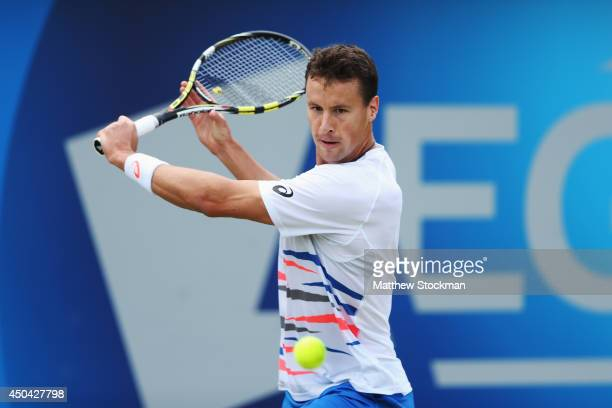Kenny De Schepper of France plays a backhand against Ernests Gulbis of Latvia during their Men's Singles match on day three of the Aegon...