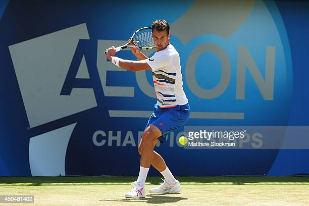 Kenny De Schepper of France plays a backhand against Feliciano Lopez of Spain during their Men's Singles match on day four of the Aegon Championships...