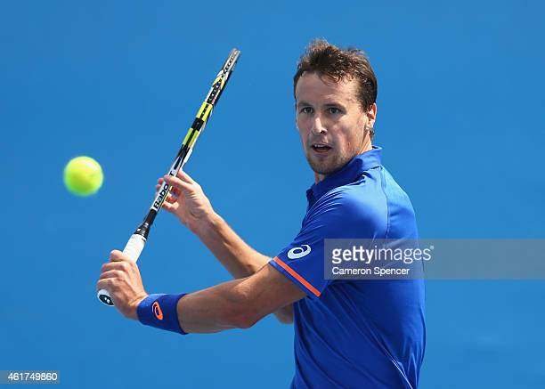 Kenny De Schepper of France plays a backhand in his first round match against Lukas Rosol of the Czech Republic during day one of the 2015 Australian...