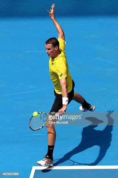 Kenny De Schepper of France plays a backhand in his second round match against Tomas Berdych of the Czech Republic during day three of the 2014...
