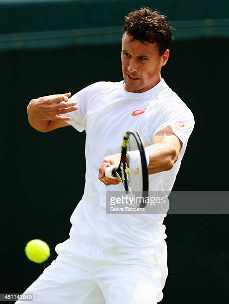 Kenny De Schepper of France reacts during his Gentlemen's Singles first round match against Kei Nishikori of Japan on day two of the Wimbledon Lawn...
