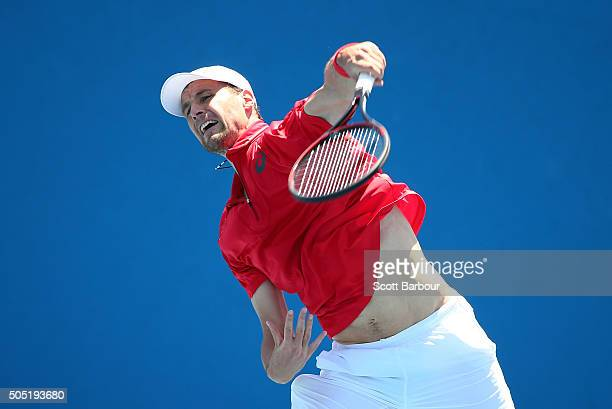 Kenny De Schepper of France serves in his match against Tim Smyczek of the United States during the third round of 2016 Australian Open Qualifying at...
