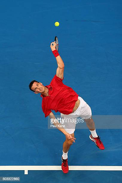 Kenny De Schepper of France serves in his singles match against Andy Murray of Great Britain during day two of the 2016 Hopman Cup at Perth Arena on...