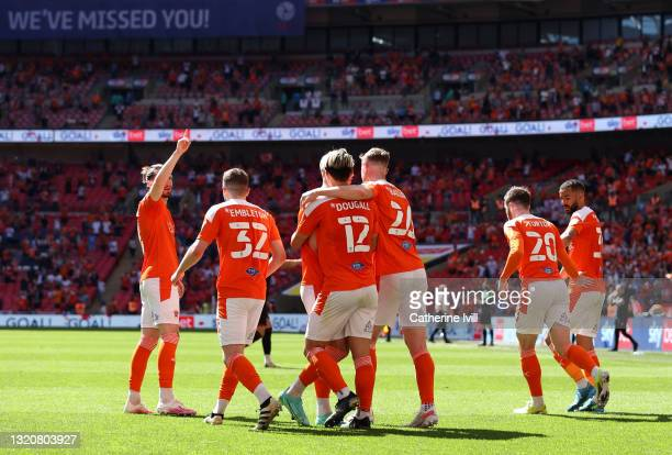 Kenny Dougall of Blackpool celebrates with Daniel Ballard after scoring their side's first goal during the Sky Bet League One Play-off Final match...
