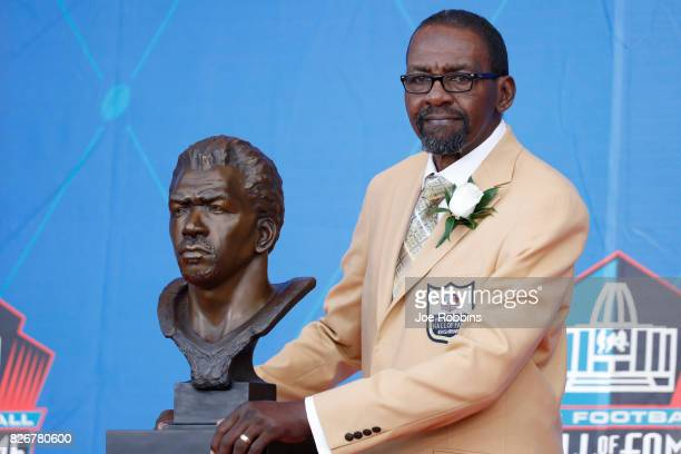 Kenny Easley poses with his bust during the Pro Football Hall of Fame Enshrinement Ceremony at Tom Benson Hall of Fame Stadium on August 5 2017 in...
