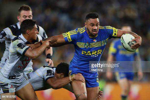 Kenny Edwards of the Eels is tackled during the NRL Semi Final match between the Parramatta Eels and the North Queensland Cowboys at ANZ Stadium on...