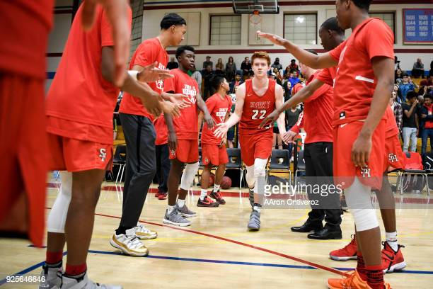 Kenny Foster of the Smoky Hill Buffaloes is introduced against the East High Angels before the first half of their class 5A round of 16 game on...