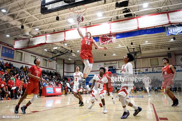 Kenny Foster of the Smoky Hill Buffaloes throws down a dunk against the East High Angels during the second half of Smoky Hill's 7672 win in their...