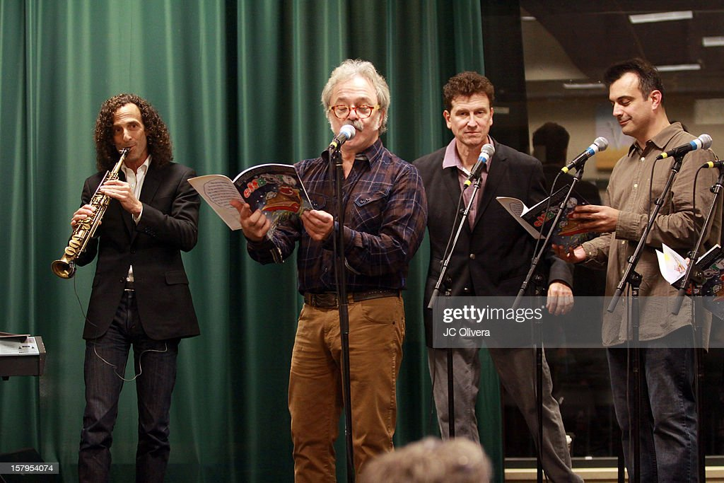 Kenny G, Jim Cummings, Roger Rose and Greg Boghosian perform during a live Interactive reading event of 'ELFBOT' inside Barnes & Noble at The Americana at Brand on December 7, 2012 in Glendale, California.