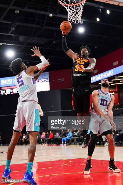 Kenny Gabriel of the College Park Skyhawks dunks against the Greensboro Swarm during the second quarter of an NBA GLeague game on December 3 2019 at...