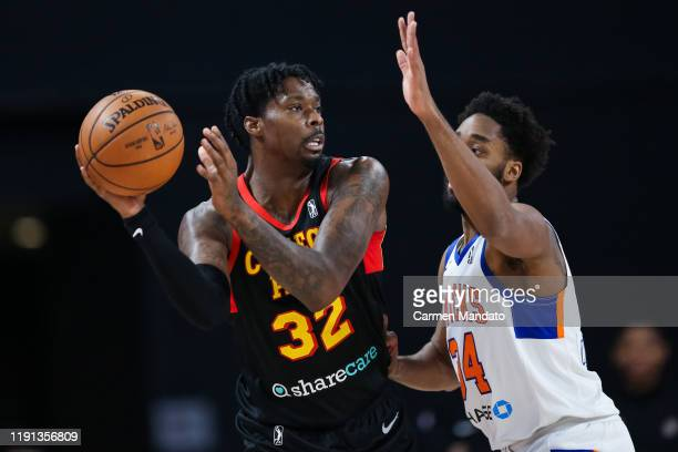 Kenny Gabriel of the College Park Skyhawks looks to pass in front of Tim Bond of the Westchester Knicks during an NBA GLeague game on January 2 2020...