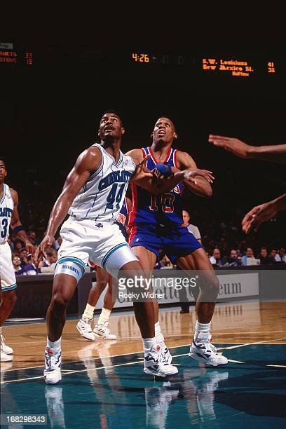 Kenny Gattison of the Charlotte Hornets boxes out against Dennis Rodman of the Detroit Pistons during a game played on March 22 1992 at the Charlotte...