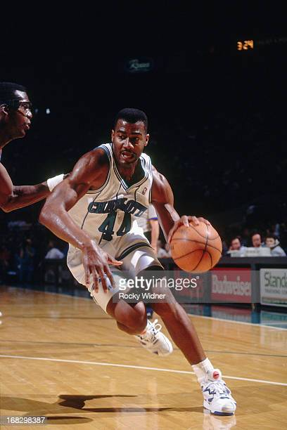 Kenny Gattison of the Charlotte Hornets drives against the Detroit Pistons during a game played on March 22 1992 at the Charlotte Coliseum in...