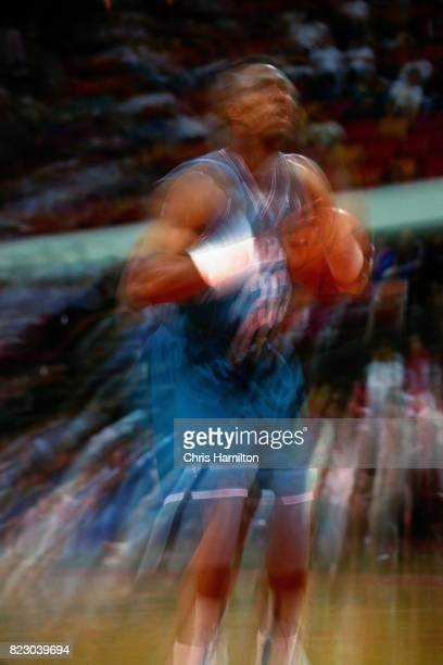 Kenny Gattison of the Charlotte Hornets shoots a foul shot against the Atlanta Hawks at the Omni Coliseum in Atlanta Georgia circa 1992 NOTE TO USER...