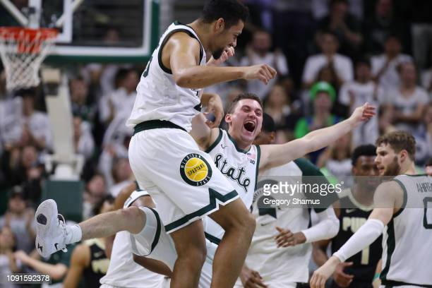 Kenny Goins of the Michigan State Spartans celebrates after a second half timeout was called with Foster Loyer while playing the Purdue Boilermakers...