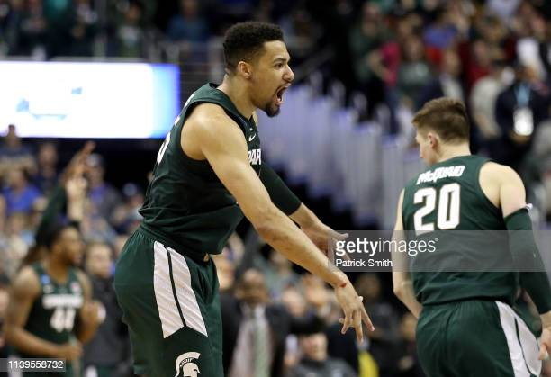 Kenny Goins of the Michigan State Spartans celebrates his three point basket late in the game against the Duke Blue Devils during the second half in...