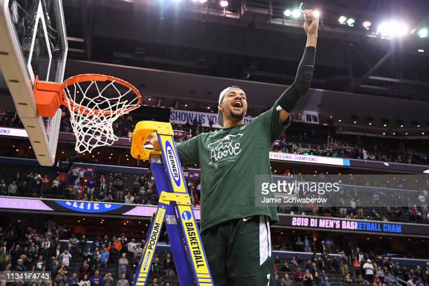 Kenny Goins of the Michigan State Spartans cuts down the net after their victory over the Duke Blue Devils in the Elite Eight round of the 2019 NCAA...