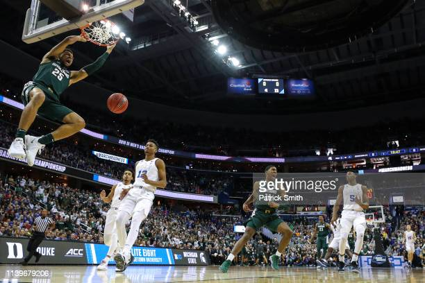Kenny Goins of the Michigan State Spartans dunks the ball against the Duke Blue Devils during the first half in the East Regional game of the 2019...