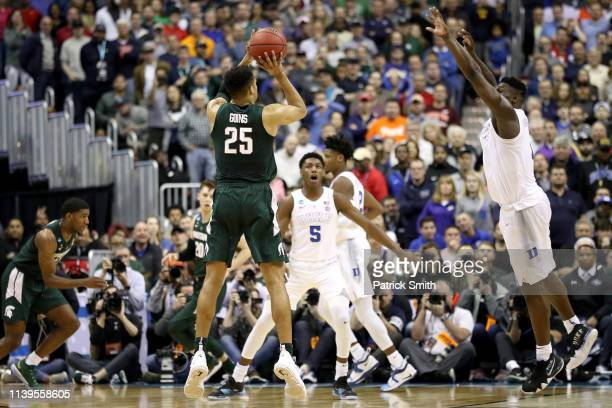 Kenny Goins of the Michigan State Spartans hits a three point basket late in the game against Zion Williamson of the Duke Blue Devils during the...