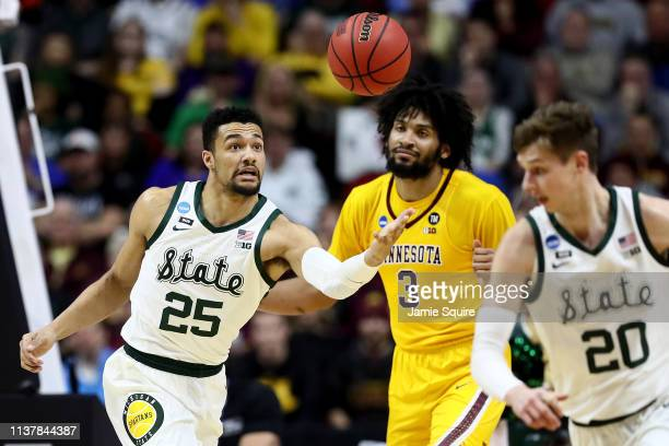 Kenny Goins of the Michigan State Spartans looks for the ball against Jordan Murphy of the Minnesota Golden Gophers during the first half in the...