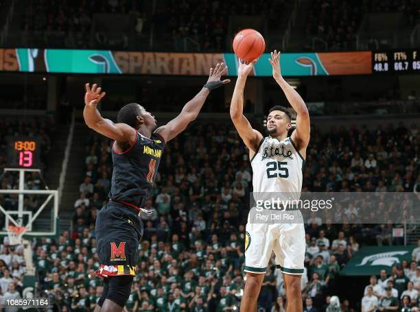 Kenny Goins of the Michigan State Spartans shoots the ball over Darryl Morsell of the Maryland Terrapins in the second half at Breslin Center on...